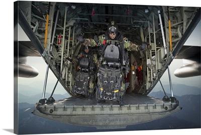 U.S. Navy SEALs combat diver prepares for HALO jump operations from a C-130 Hercules