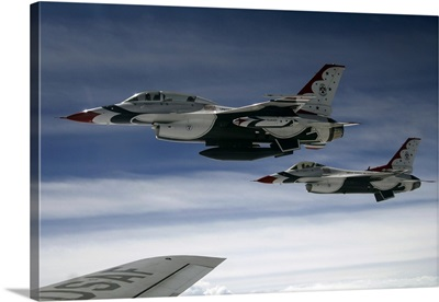 US Air Force F-16 aircraft fly off the wing of a KC-135 Stratotanker