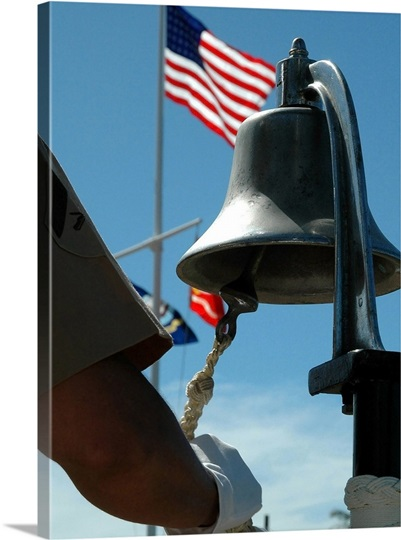 US Marine sounds a bell honoring fallen Marines during a ceremony