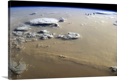 View of a dust storm that stretches across the sand seas of the Sahara Desert