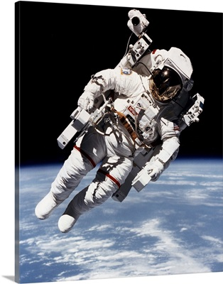 Bruce McCandless floating free from spacecraft in orbit, 1984