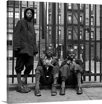 Three boys on the sidewalk in Harlem, New York City, 1943