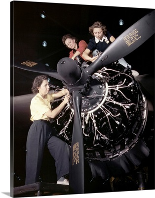 Women installing an aircraft engine at the Douglas Aircraft plant, Long Beach, CA, 1942
