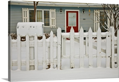 A gate and fence in winter