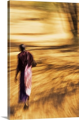 An African Masai tribesman walking with motion blur