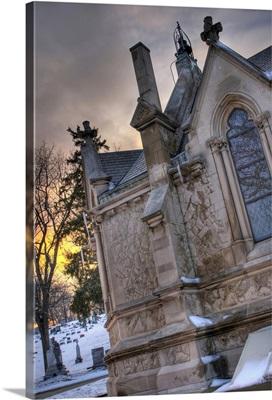 Church window at dusk in Calvary Cemetery Dayton, Ohio