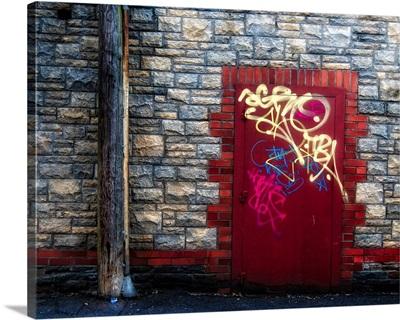 Derelict door with graffiti and lampost