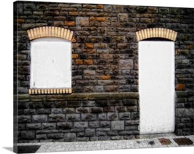 Filled in derelict doorway and window