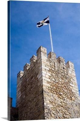 The Lisbon flag fluttering on the top of Saint George castle
