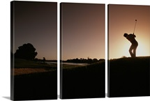 A man plays a game of golf at twilight, South Africa