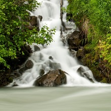 A cascading waterfall flows into Granite Creek, Turnagain Pass, Chugach National Forest