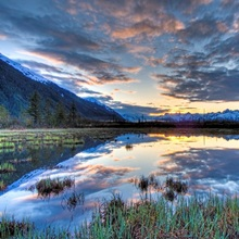 Morning sky reflecting on a pond near the Copper River Highway outside of Cordova