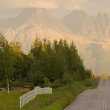 Rural road leading to view of Chugach Mountains near Palmer, Alaska