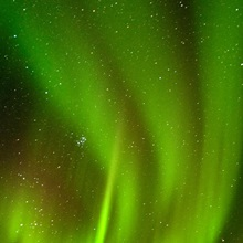 View of Aurora Borealis dancing above Noatak River