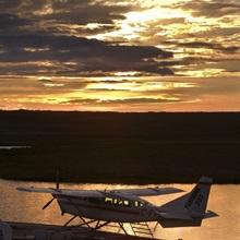 Plane on Whitefish Lake at sunset, Northwest Territories; Canada