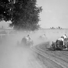 Racecars rounding a turn at the Rockville Fair auto races, August 25, 1923