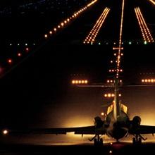 Airplane on runway at night