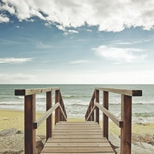 Beach with wooden pier in Spain.