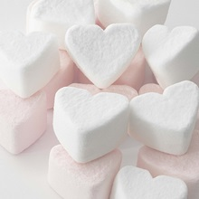 Selection of pink and white heart shaped marshmallows.