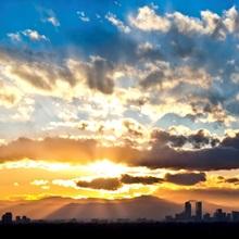 Sun Bursts over Denver during Sunset; Denver, Colorado
