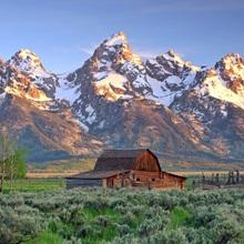 An old Mormon barn sits at the base of Grand Teton