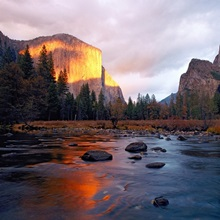 Evening sun lights up El Capitan and the Merced River, Yosemite National Park, California
