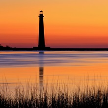 Silhouetted Morris Island lighthouse at sunrise