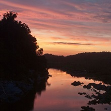 Sunset colors the Potomac River viewed from Chain Bridge Road, Virginia