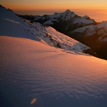 Sunset glow over a glacier, Southern Alps, South Island, New Zealand