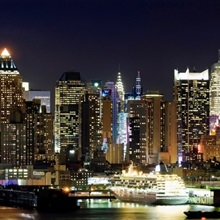 Buildings in a city lit up at night, Hudson River, Midtown Manhattan, Manhattan, New York City, New York State,