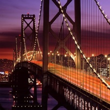 California, San Francisco, Bay Bridge illuminated at night