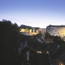 Castle lit up at dusk, Cesky Krumlov Castle, Cesky Krumlov, South Bohemia, Czech Republic