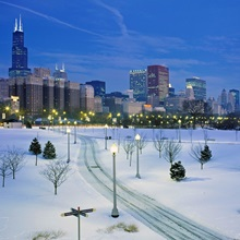 High angle view of snow covered landscape with buildings in the background, Chicago, Illinois