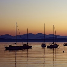 Silhouette of boats in a lake, Lake Champlain, Vermont