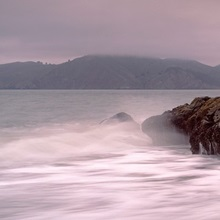 Waves breaking on rocks, Golden Gate Bridge, Baker Beach, San Francisco, California