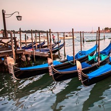 Blue Gondolas in a Row at Sunset, Venice, Italy, Europe