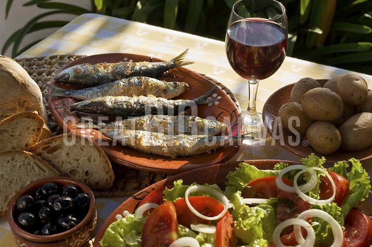 https://static.greatbigcanvas.com/images/zoom/estock/portugal-typical-rustic-algarve-meal-grilled-sardines-bread-salad-a-glass-of-wine,2268372.jpg?max=750